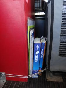 Our bookshelf on the road, handy at any time and a little elastic ensures they don't keep falling over.