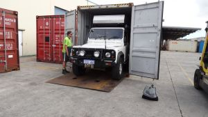 reversing Lara into the container