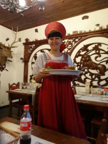 delicious food served in traditional Russian dress