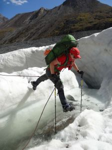 crampons and big backpack make it difficult to cross small streams