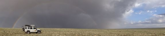 Lara and rainbow in the Gobi Desert