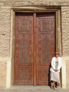 covering up for the first time to visit the mausoleum - beautiful carved doors