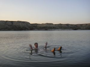 floating dead sea style in the small salt lake
