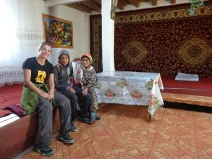 inside a large traditional Pamir home with Ruslan and his grandmother