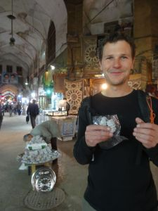 trying some local delicacies in the bazaar of Esfehan