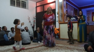 Jude is dressed in typical Kurdish dress after we join this family for dinner