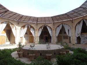rooms and a restaurant around the courtyard in caravan-serai Zein-o-din