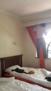 Nick helping with hanging the new curtains