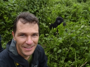 Jon with a very cute and young gorilla who rolled to our feet
